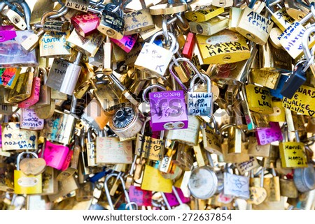 PARIS, FRANCE - CIRCA JAN 2015: Love Padlocks at Pont de l'Archevche in Paris. The thousands of locks of loving couples symbolize love forever. - stock photo