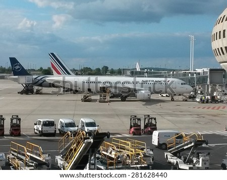 PARIS, FRANCE - CIRCA MAY, 2015: Air France Airbus A320 jet at the gates at Charles De Gaulle Airport. Air France is the French flag carrier and subsidiary of the Air France-KLM Group