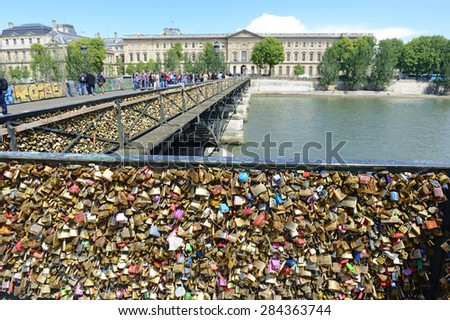PARIS FRANCE. CIRCA MAY 2015. Paris started removing love locks from the Pont des Arts Bridge as their collective weight could cause the bridge to collapse, endangering visitors and ferry passengers. - stock photo