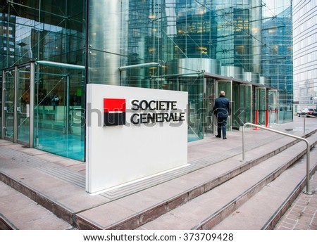 PARIS, FRANCE - DEC 3, 2014: Businessman entering through the Societe Generale Headquarter entrance in La Defense. Societe Generale is the 7th largest bank in Europe (Q4 2015) - stock photo