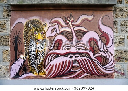 PARIS, FRANCE -24 DEC 2015- Colorful graffiti street art by muralist Mosko et Associes in Paris.