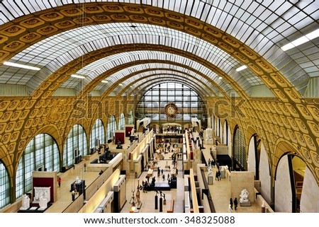 PARIS, FRANCE -5 DEC 2014- Visitors at the Musee d'Orsay in Paris. Located in the former Gare d Orsay train station, the museum has the largest collection of impressionist paintings in the world. - stock photo