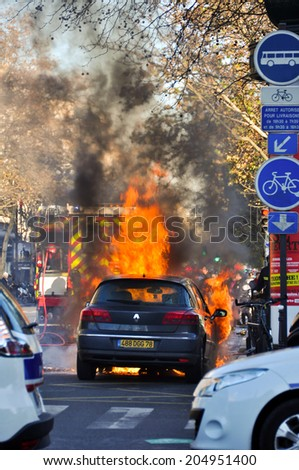 PARIS, FRANCE - DECEMBER 2: Accident in the streets of Paris on 2 December 2012. The car was set on fire by vandals. - stock photo