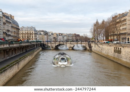 Paris, France - December 20, 2014: Boat trip on the Seine. Popular form of recreation for tourists. - stock photo