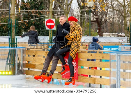 Paris, France - December 20, 2014: Christmas ice rink on the Champs Elysees in Paris. Tourists citizens and their children are happy to skate in the Christmas holidays. - stock photo