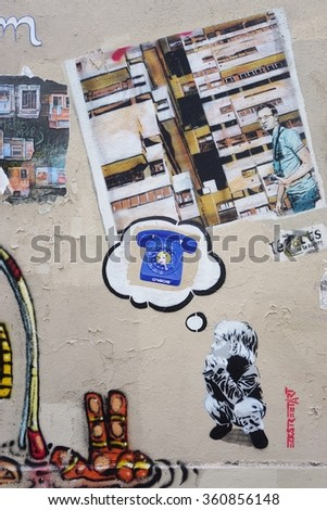 PARIS, FRANCE -16 DECEMBER 2015- Colorful graffiti art by famous muralists line the street walls and back alleys of the Butte-aux-Cailles neighborhood in the 13th arrondissement of the French capital.