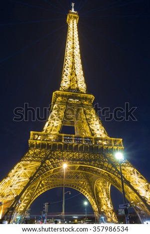 Paris; France- December 07; 2015:  Eiffel tower is one of the most visited monument in the world.It located on the bank of Seine river in Paris, France. - stock photo
