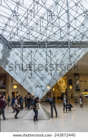PARIS, FRANCE - DECEMBER 22, 2014: Inside the Louvres pyramid. Louvre Museum is one of the largest and most visited museums worldwide. - stock photo