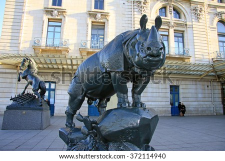 PARIS, FRANCE -18 DECEMBER 2011: Rhinoceros statue in front of museum D'Orsay