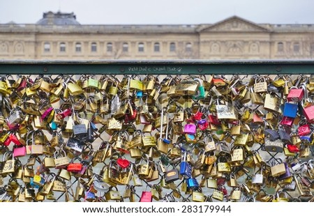 PARIS, FRANCE --6 DECEMBER 2014-- The city of Paris is locking down on the tourists' habit of attaching metal locks to the French capital's bridges to symbolize their eternal love.  - stock photo