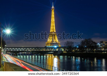 Paris; France-December 09, 2015 : The Eiffel tower is a lattice tower on the Champ de Mars in Paris, France.The tower is the tallest structure in Paris and the most visited monument in the world. - stock photo