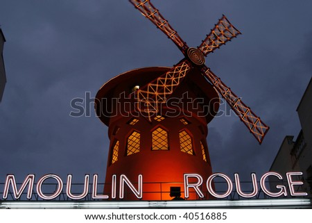 PARIS, FRANCE - DECEMBER 30: The Moulin Rouge by night, on December 30, 2007 in Paris, France. Moulin Rouge is a famous cabaret built in 1889, locating in the Paris red-light district of Pigalle - stock photo
