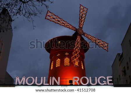 PARIS, FRANCE - DECEMBER 30: The Moulin Rouge by night, shown on December 30, 2007 in Paris, France. The Moulin Rouge is a famous cabaret built in 1889 and located in the Paris' red-light district of Pigalle.