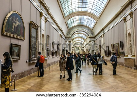 PARIS, FRANCE - DECEMBER 22, 2014: Tourists visit Louvre Museum. Louvre Museum is one of the largest and most visited museums worldwide. - stock photo