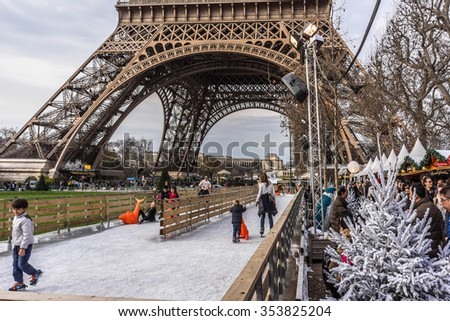 PARIS, FRANCE - DECEMBER 16, 2015: Traditional Christmas markets and ice rink near the Eiffel tower on Champ de Mars in Paris. - stock photo