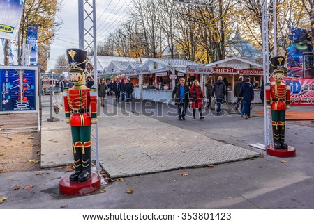 "PARIS, FRANCE - DECEMBER 16, 2015: Traditional Christmas markets of the Champs Elysees ""Marche de Noel des Champs Elysees""."