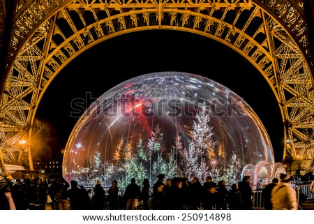 PARIS, FRANCE - DECEMBER 22, 2014: View a Christmas tree near Eiffel Tower. Eiffel Tower is the highest iconic monument in France. - stock photo