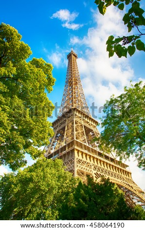 PARIS, FRANCE, Eiffel tower day against the blue sky, close-up - stock photo