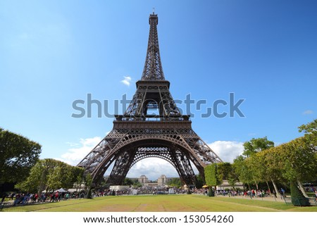 Paris, France - Eiffel Tower seen from Champ de Mars. UNESCO World Heritage Site. - stock photo