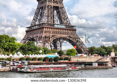 Paris, France - embankment of river Seine with Eiffel Tower in background - stock photo