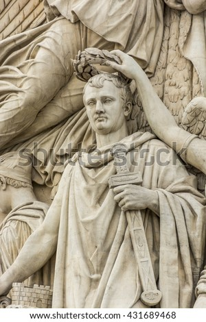 PARIS, FRANCE, EU - SEPTEMBER 17, 2013: Triunph Arch orArc de Triomphe in Paris . Detail of sculpture of Napoleon