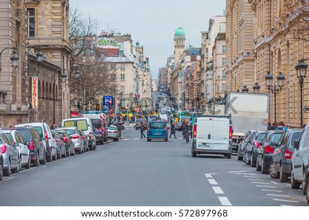 PARIS, FRANCE - FEB. 05, 2016: Streets of Paris, France. Blue sky, buildings and traffic