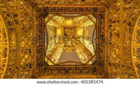 Paris, France - 11 February 2016: A Beautiful Ground Up View of Eiffel Tower Lights Up at Night. - stock photo