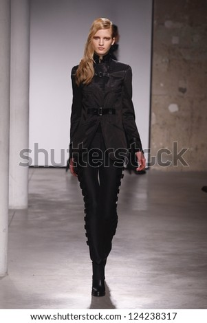 PARIS, FRANCE - FEBRUARY 29: A model walks the runway during the Atsuro Tayama Ready to Wear Fall/Winter 2011 show as part of the Paris Fashion Week on February 29, 2012 in Paris, France