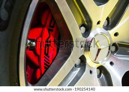 PARIS, FRANCE - FEBRUARY 20, 2014: Close up of the wheel of the Mercedes G63 AMG in the iconic stars showroom on the Champs Elysees in Paris, France, on February 20, 2014 - stock photo
