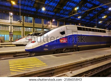 PARIS, FRANCE -25 FEBRUARY 2015- Editorial: Modern high-speed bullet TGV and regional trains leave Paris from the historic Gare de Lyon station, built for the 1900 World Exposition.