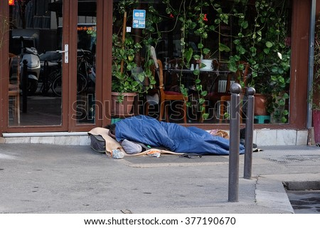Paris, France, February 11, 2016: homeless people in a center of Paris, France.  - stock photo