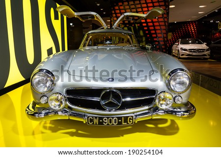 PARIS, FRANCE - FEBRUARY 20, 2014: Mercedes 300 SL Gullwing in the iconic stars showroom on the Champs Elysees in Paris, France, on February 20, 2014