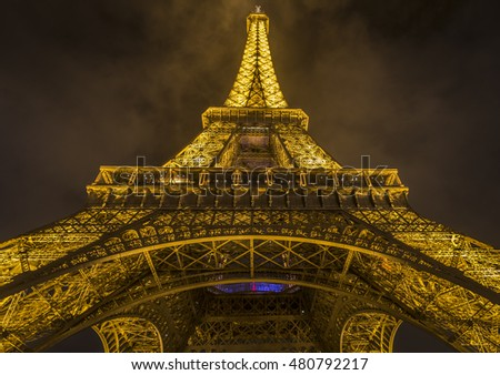 Paris, France - February 14, 2016: Night photography from bottom to up with the Eiffel Tower, in Paris, France, on 14 February 2016