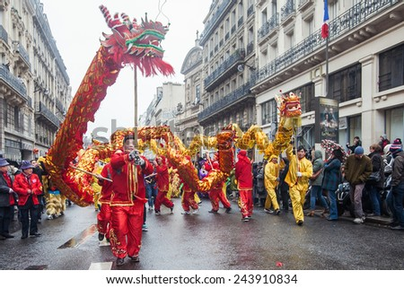 PARIS, FRANCE - FEBRUARY 10: Parade participants hold fairy dragon. Chinese New Year parade shown on February 10, 2013 in Paris, France - stock photo