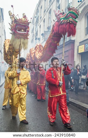 PARIS, FRANCE - FEBRUARY 10: Parade participants hold fairy dragon. Chinese New Year parade shown on February 10, 2013 in Paris, France