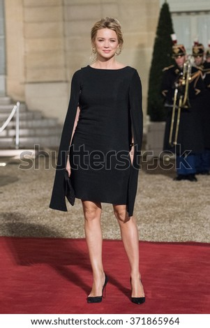 PARIS, FRANCE - FEBRUARY 1, 2016 : The Belgium actress Virginie Efira arriving at the Elysee Palace for the state diner in the honor of the President of Cuba Raoul Castro for his visit in France. - stock photo