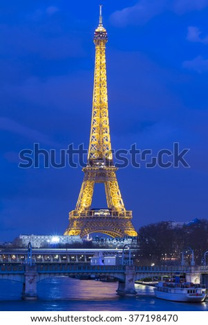 Paris, France-February 15, 2016 : The Eiffel tower is a historical monument ,one of the most visited in the world, located on the bank of Seine river in Paris, France. - stock photo
