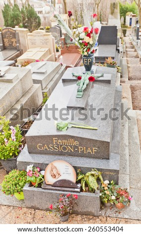 PARIS, FRANCE - FEBRUARY 21, 2015: Tomb of Edith Piaf on Pere Lachaise Cemetery in Paris. Edith Piaf (1915-1963) was a French cabaret singer who became widely regarded as Frances national diva - stock photo