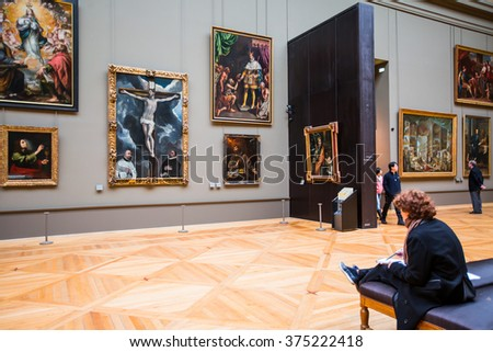 PARIS, FRANCE - FEBRUARY 06, 2016: Tourists visit art gallery in Louvre Museum. Louvre Museum is one of the largest and most visited museums worldwide. - stock photo
