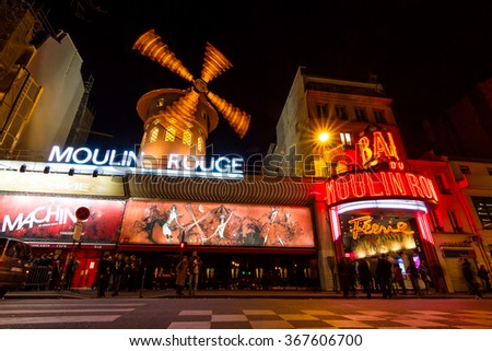 PARIS, FRANCE - FEBRUARY 23, 2014: World famous cabaret club the Moulin Rouge at night in Paris, France, on February 23, 2014