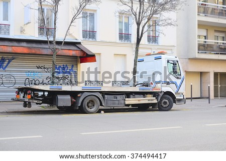 Paris, France, February 7 , 2016: wrecker on a parking in Paris, France