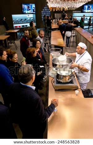 PARIS, FRANCE - JAN; 26, 2015: An Italian cook shows how to cook Mozzarella at Maison et Objet, the French leading professional trade show for home fashion and design.