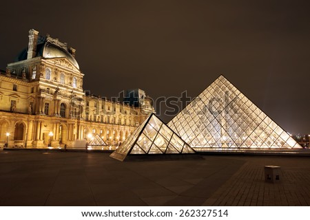 PARIS, FRANCE - JAN 03 : Louvre museum at twilight in winter on January 03 ,2013. Louvre museum is one of the world's largest museums with more than 8 million visitors each year. - stock photo