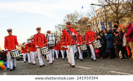 PARIS, FRANCE - JANUARY 1, 2015: Altesa orchestra (from De Zilk, Netherlands) participates in the New Year Parade on  Avenue des Champs-Elysees. Colorful New Year Parade is annual event. - stock photo