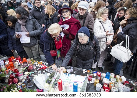PARIS, FRANCE - January 10, 2016: ceremony to commemorate victims of the bombing and shooting rampage, commemoration of Charlie Hebdo terrorist attack and of Marches Republicaines demonstration - stock photo