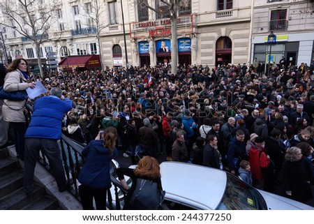 Paris, France - January 11, 2015:  demonstration in solidarity with the attack against Charlie Hebdo in Paris, France on 11 January, people holding a sign.  - stock photo