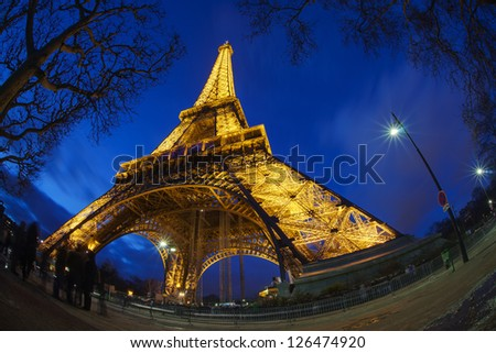 PARIS, FRANCE- JANUARY 01: Eiffel tower at night. The Eiffel tower is the most visited monument of France. January 1, 2013 - stock photo