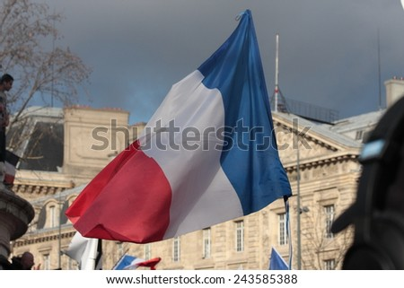 PARIS, FRANCE-JANUARY 11, 2015: French flag in manifestation on Republic Square in Paris against terrorism and in memory of the attack against satirical newspaper Charlie Hebdo.  - stock photo