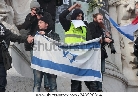 PARIS, FRANCE-JANUARY 11, 2015: Israeli Flag during manifestation on Republic Square in Paris against terrorism and in memory of the attack against satirical newspaper Charlie Hebdo.  - stock photo