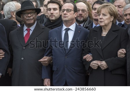 """PARIS, FRANCE - JANUARY 11, 2015 : """"Je suis Charlie"""" - Republican march organized by France following the terrorist attack against the newspaper Charlie Hebdo - stock photo"""